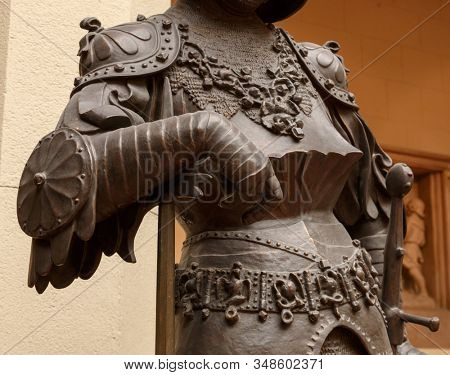 Sculpture of King Arthur old metal statue. Medieval knights armor full size standing warrior. Order of the Knights Templar and an iron knight's armour