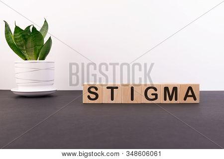 Stigma Word Made With Building Blocks On A Light Background