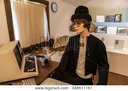Typical Office Workspace In The 1980s With First Vintage Pc. Female Mannequin In Casual Clothing Of