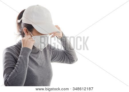 Woman With Gray Shirt Wearing A Mask Isolated On White Background. Promoting People Use Face Mask To