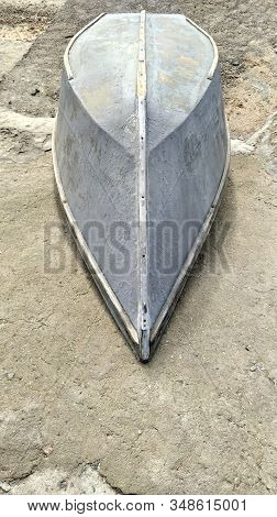 Grey Boat On An Empty Sand Beach. Cloudy Sky Day. Monochrome Minimal Style Wallpaper.travel Photogra