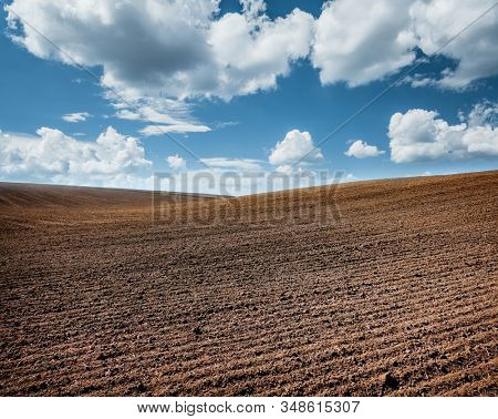 Picturesque rural area and plowed field on the springtime. Location place of Ukrainian agrarian region, Europe. Photo of ecology concept. Agrarian industry. Perfect wallpapers. Beauty of earth.