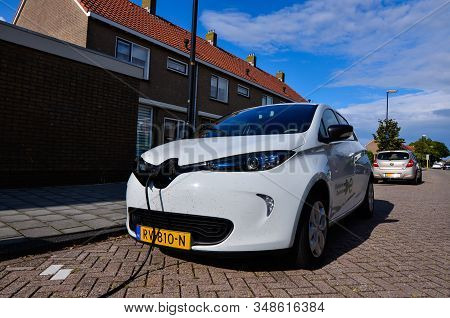 Edam, The Netherlands, August 2019. A Renault Zoe Connected To The Electric Charging Station. The Ch