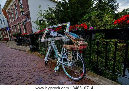 Edam, The Netherlands, August 2019. Street Art Represented By A Bicycle In Varied Colors