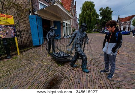 Edam, Netherlands, August 2019. The Square Where The Characteristic Cheese Market Takes Place. A Met