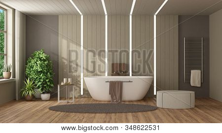 Brown And Beige Modern Bathroom With Bathtub Against Wooden Paneling With Led Light - 3d Rendering