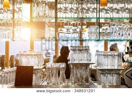 Ischgl, Austria - January 10th, 2020: Wall Of Many Empty Transparent Wine And Beer Glasses On Glass