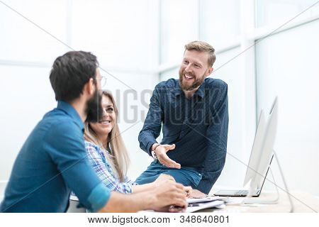 Professional Business Team Discussing Business Documents.photo With Space For Text