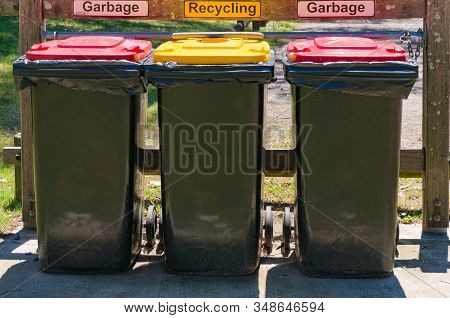 Sydney, Australia - November 12, 2016: Outdoors Kerbside Rubbish Bins With Red And Yellow Lids For R
