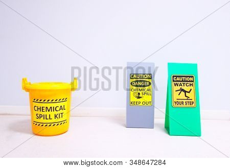 The Chemical Spill Kit Yellow Bucket And Warning Danger Caution Hazard Tag Sign Or Symbol For Emerge
