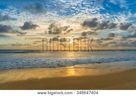 Beautiful Summer Beach Vacation Background With Soft Waves, Sand And Golden Clouds And Sun. Summerti