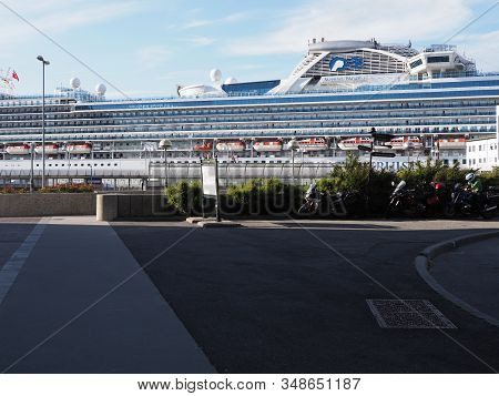 Alesund, Norway On July 2019: Giant Cruise Liner In Port Of European Town At Romsdal Region With Clo