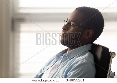 African Worker Resting Seated On Ergonomic Office Chair At Workplace