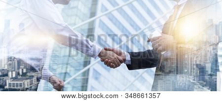 Business Partnership Meeting Concept. Businessmen Making Handshake In The City. Successful Businessm