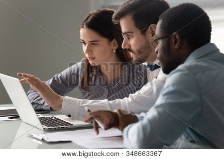 Team Leader Showing To Interns Corporate Program During Group Meeting