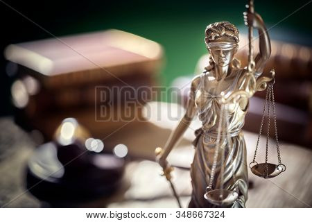 Legal and law concept statue of Lady Justice with scales of justice and judge gavel