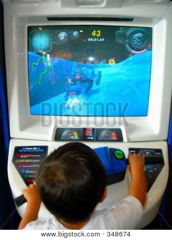 Boy Playing Aracde Game