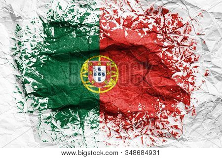 The National Flag Of The Portugal Is Painted On Crumpled Paper. Flag Printed On The Sheet. Flag Imag