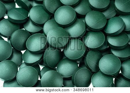 Vitamin And Mineral Supplements For Vegetarians Spirulina In Tablets On A White Background, Close-up