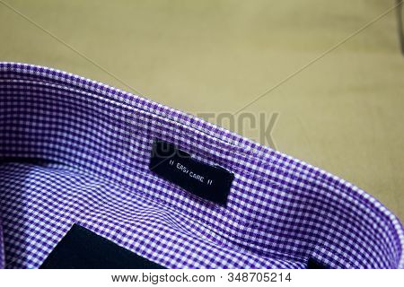 Ironed Shirt And Trouser Placed Over One Another. New Shirt Over Khaki Coloured Pant.