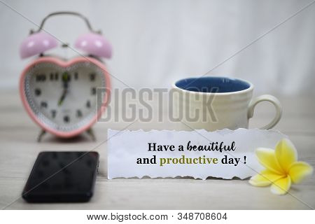Inspirational Quote - Have A Beautiful And Productive Day. With Blurry White Background Of A Cup Of