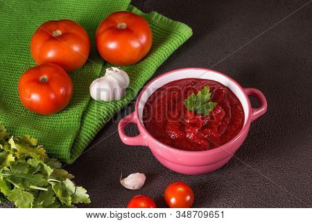 Tomato Soup With Parsley, Onion And Garlic On Gray Background. Comfortable Food. Rustic Style..