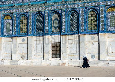 Arab Women In Hijab, Burka Walking Near The Dome Of The Rock Islamic Shrine On The Temple Mount In T