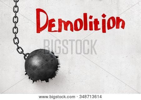 3d Rendering Of Wrecking Ball That Has Broken Hole In Concrete Wall With Title Demolition.