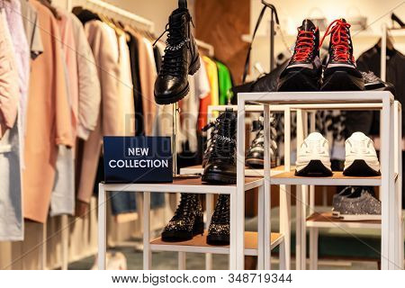 Plate With Inscription New Collection, Clothing Racks With Colorful Male, Female Clothes On Hangers,