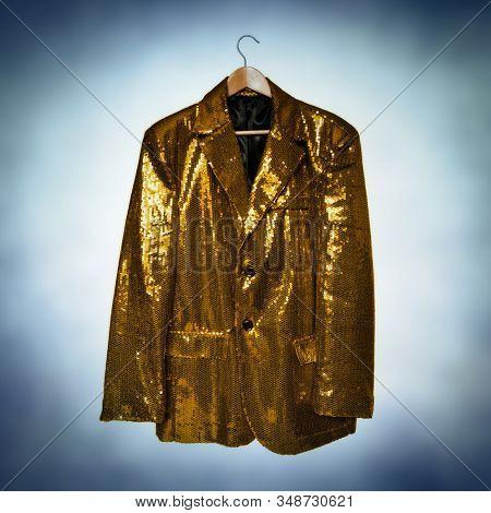 gold sequined jacket on hanger