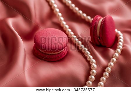 Sweet Macaroons And Pearls Jewellery On Silk Background, Parisian Chic Jewelry, French Dessert Food