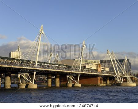 Hungerford bridge at sunset in London, England, UK