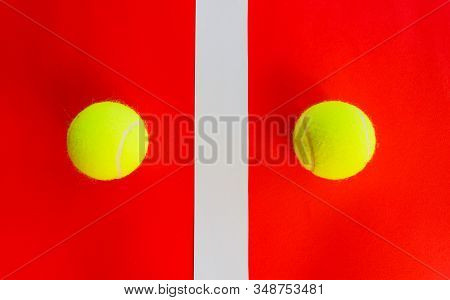 Two Tennis Balls Divided By A Field Line / Two Tennis Balls Divided By A Field Line They Represent A