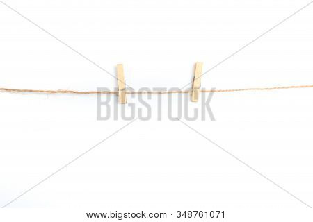 Isolated Clothespins. Wooden Clothespins On Rope Isolated On White Background With Clipping Path - I
