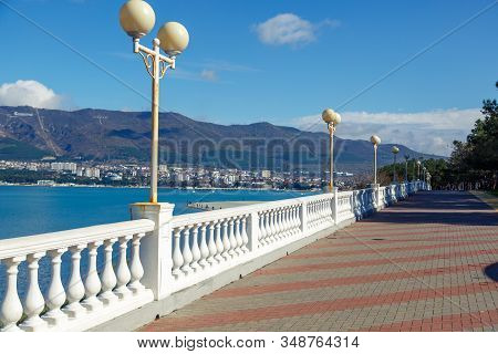 Gelendzhik Embankment In The Early Morning. The Balustrade Goes Into The Distance. Caucasus Mountain