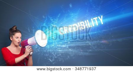 Young person shouting in loudspeaker with CREDIBILITY inscription, business concept poster