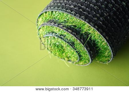Artificial Grass Roll On A Green Background