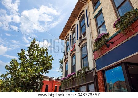 Old historic buildings in downtown Bloomington Indiana, shallow focus in center of building windows and downspouts