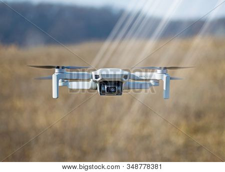 With Dji Drone In The Nature. The Smallest Drone Launched By The Dji Company. A Drone Weighing Only