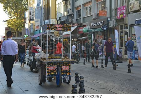 Istanbul, Turkey - September 17th 2019. A Chestnut Vendor Waits For Customers  In A Busy High Street