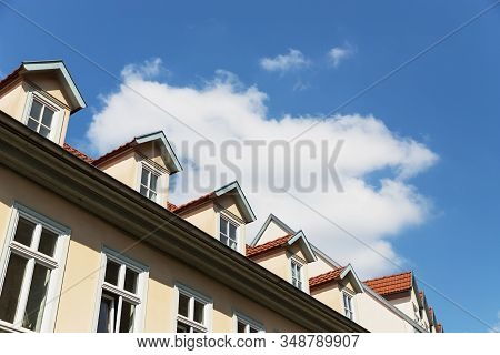 House In Erfurt, Germany. Details, Fragment. Windows And Sky