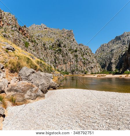 Beautiful Summer Landscape Of Nature In Mallorca Island. River Torrent De Pareis Between Rocky Mount