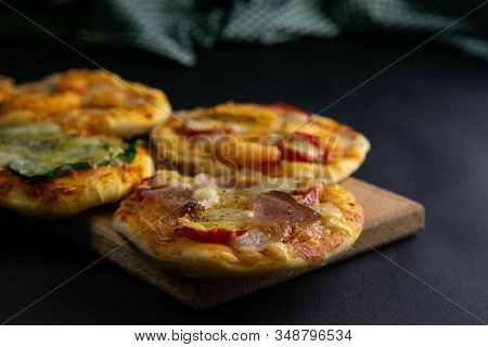 Small Mini Pizza. Set Of Different Mini Pizzas. Pizza On Wooden Board : With Shrimp, With Mushrooms,