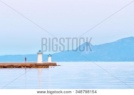 Travel By Sea. Tourism Concept. Sea Lighthouse On Mountains Background. Beautiful Seascape View With