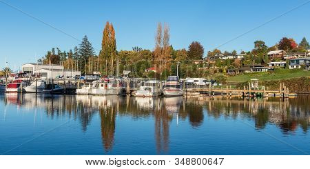 Nice Morning Reflection Of Some Boat At Taupo New Zealand.