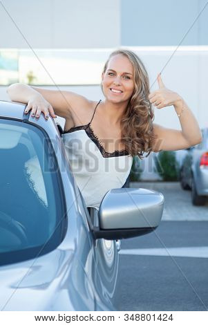 happy smiling woman with new car