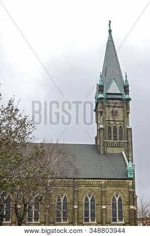 Landmark Neo-gothic Style Church Tower And Nave In Lincoln Village Neighborhood Of Milwaukee Wiscons