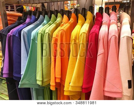 Rainbow Or Multi Color Polo Shirts On Hanger Are Hanging For Sale In Store
