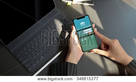Chiang Mai, Thailand - February 1, 2020 : Female Using Iphone With Online Banking Screen. Online Ban