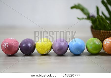 Easter Eggs On Easter Day Background With Colorful Eastereggs Lined Up, Rattan Basket Decoration On